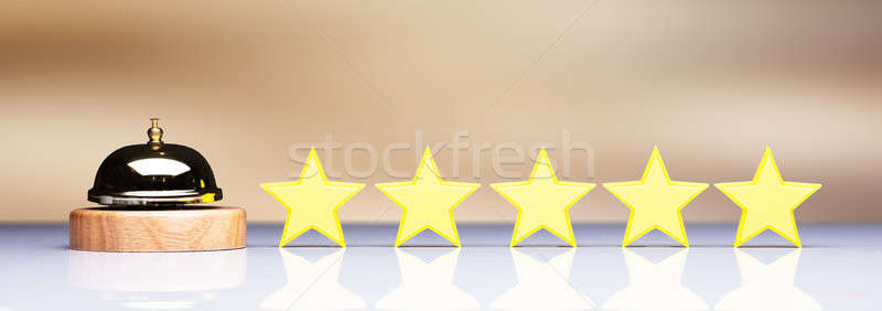 Stock photo: Golden Service Bell Beside Five Star Rating Icon
