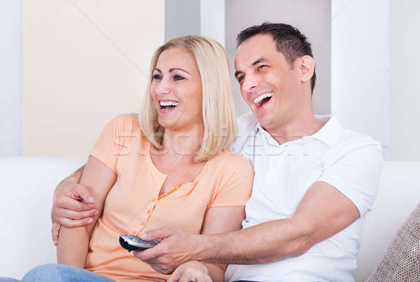 Happy Couple Watching Television Stock photo © AndreyPopov