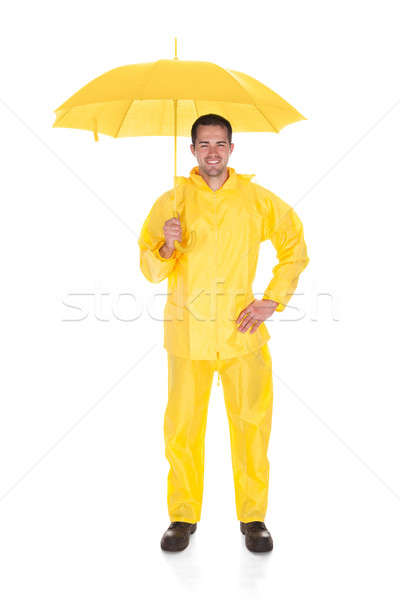 Homme mûr imperméable parapluie blanche Photo stock © AndreyPopov