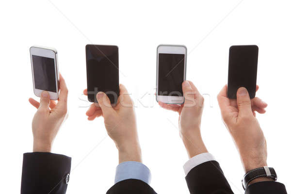 Close Up Of Human Hand Holding Cell Phone Stock photo © AndreyPopov
