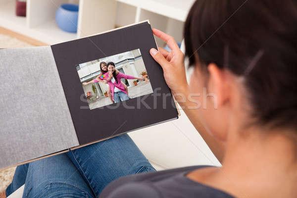 Woman With Photo Album Stock photo © AndreyPopov