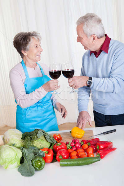 Senior Couple Toasting Wine Stock photo © AndreyPopov