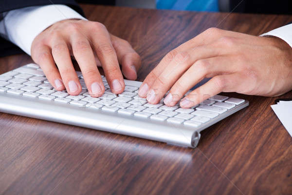 Stock photo: Businessman Typing On Computer Keyboard