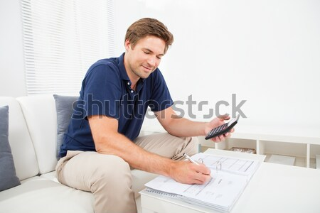 Woman sitting writing at a table Stock photo © AndreyPopov