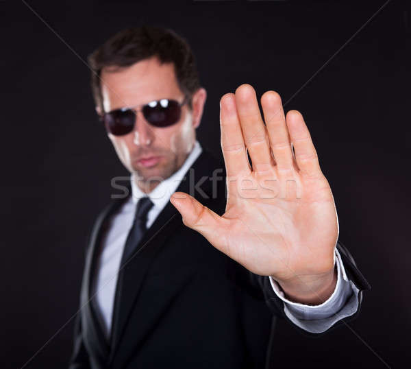 Portrait Of Young Man Making Stop Gesture Stock photo © AndreyPopov
