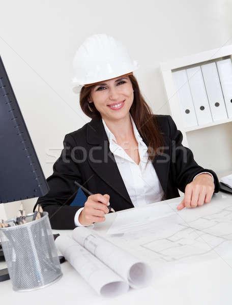 Empresária capacete de segurança blueprints retrato jovem Foto stock © AndreyPopov