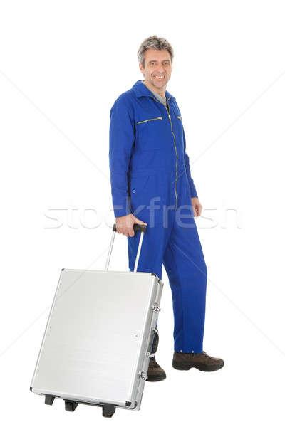 Portret permanente toolbox geïsoleerd witte glimlach Stockfoto © AndreyPopov