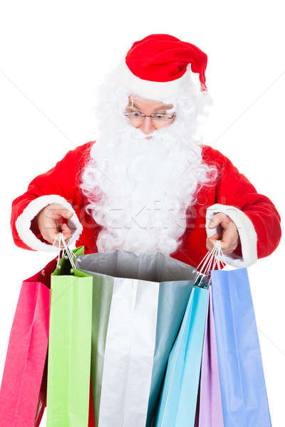 Surprised santa looking inside shopping bag Stock photo © AndreyPopov