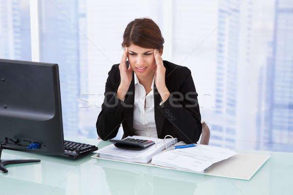 Stock photo: Stressed Businesswoman Suffering From Headache