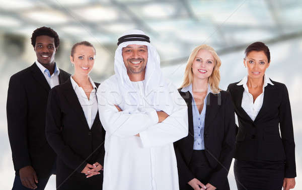 Arabic Man Standing With Businesspeople Stock photo © AndreyPopov