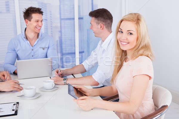 Happy Businesswoman With Colleagues In Conference Room Stock photo © AndreyPopov