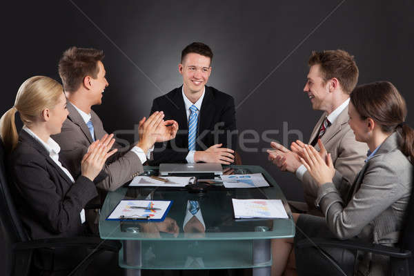 Business People Applauding For Male Colleague After Presentation Stock photo © AndreyPopov