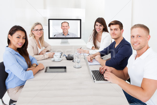 Stock photo: Business Team Attending Video Conference