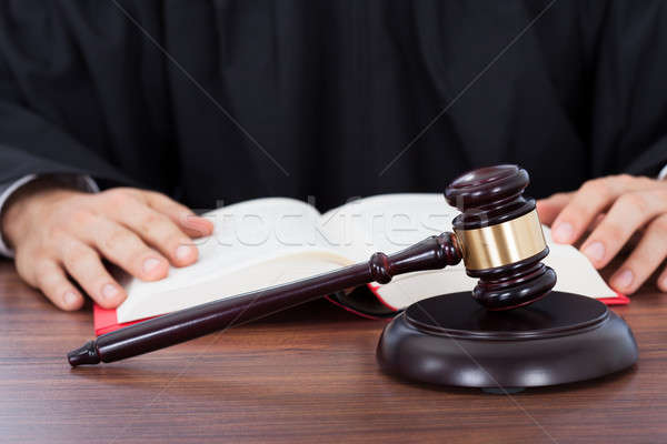 Judge Reading Law Book At Desk Stock photo © AndreyPopov