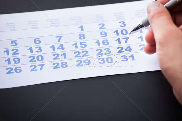 Businessman Marking On Calendar Stock photo © AndreyPopov