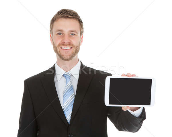 Stock photo: Smiling Businessman Displaying Digital Tablet