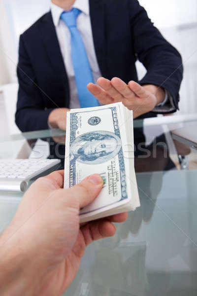 Businessman Refusing To Take Bribe From Man Stock photo © AndreyPopov