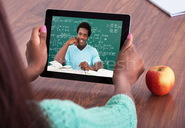 Teacher Assisting Student Through Video Conferencing Stock photo © AndreyPopov