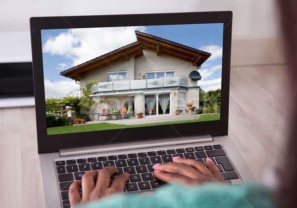 African American woman selecting new house on laptop at home Stock photo © AndreyPopov