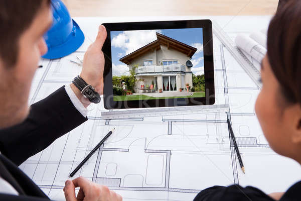Architects With Digital Tablet Looking At House Stock photo © AndreyPopov