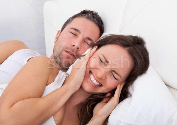 Nő férfi horkolás csalódott mögött arc Stock fotó © AndreyPopov