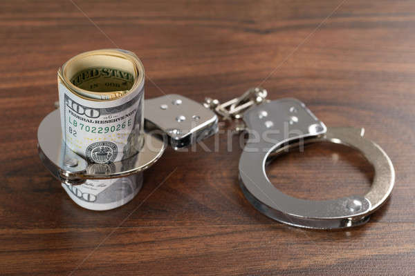 Dollar Bills With Handcuffs Stock photo © AndreyPopov