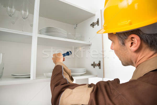 Pest Control Worker Checking Shelf Stock photo © AndreyPopov