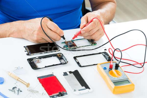 Man Repairing Cellphone Stock photo © AndreyPopov
