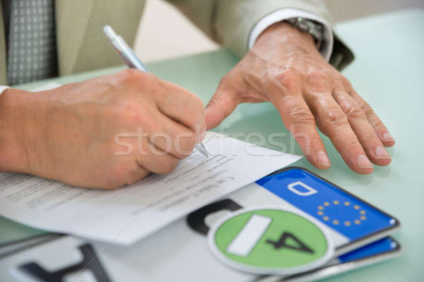 Businessman Filling Car Sale Contract Stock photo © AndreyPopov