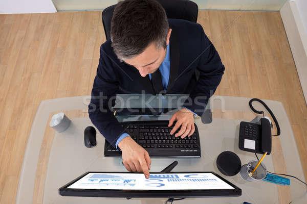 Businessman Analyzing Graph Stock photo © AndreyPopov