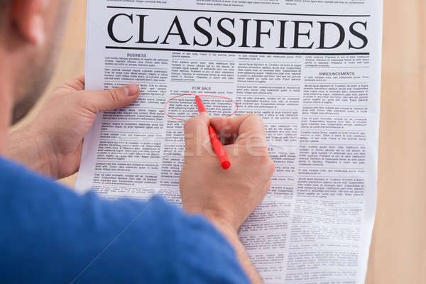 Man Looking In Classifieds For Job Stock photo © AndreyPopov