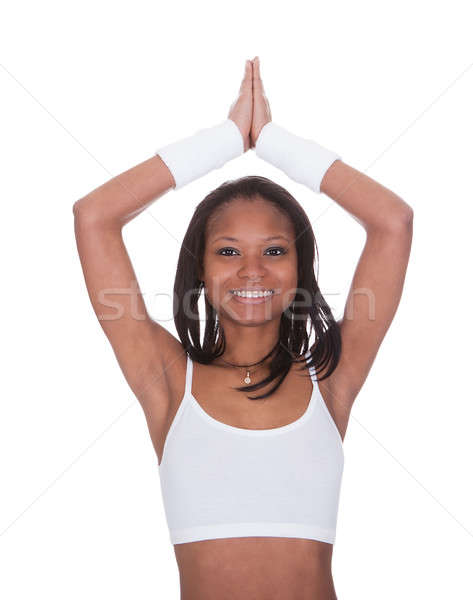 Sporty Woman Performing Yoga Against White Background Stock photo © AndreyPopov