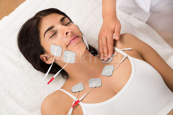 Woman Having Electrodes Therapy Stock photo © AndreyPopov