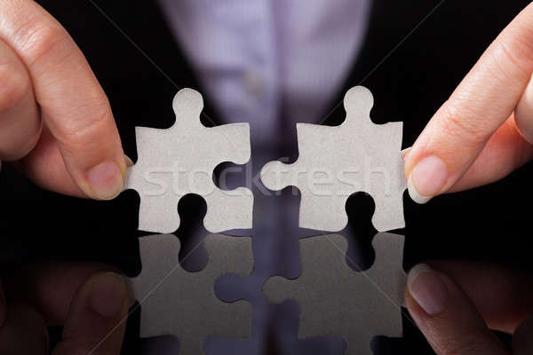 Businessperson Holding Puzzle Stock photo © AndreyPopov