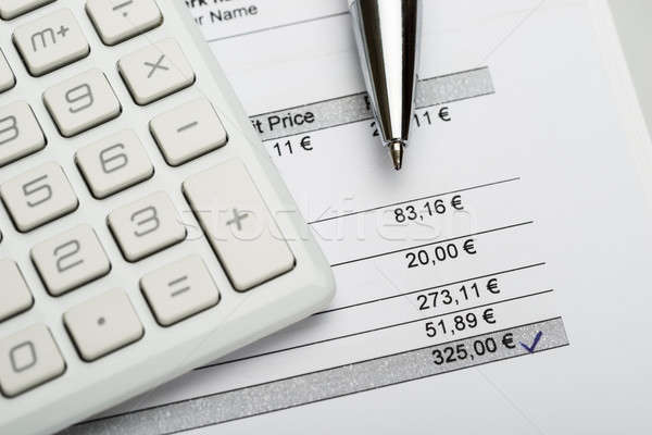 Pen With Calculator And Invoice Stock photo © AndreyPopov