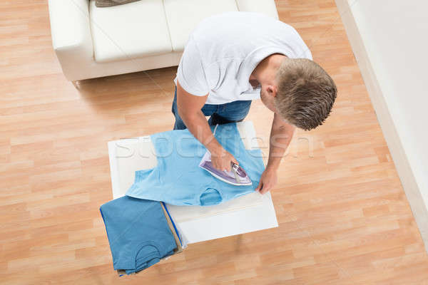 Man Ironing Clothes At Home Stock photo © AndreyPopov