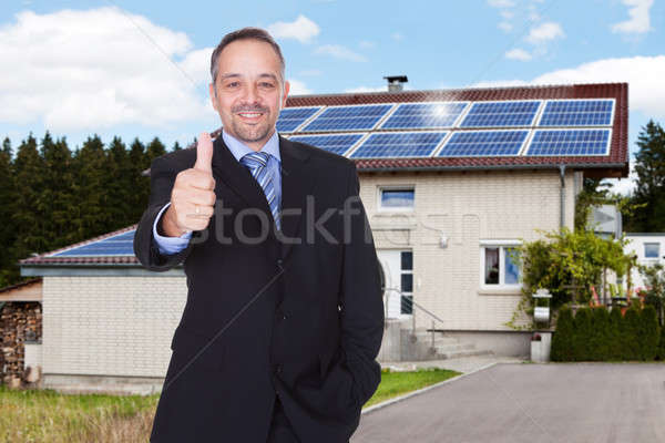 Businessman With Thumbs Up In Front Of House Stock photo © AndreyPopov
