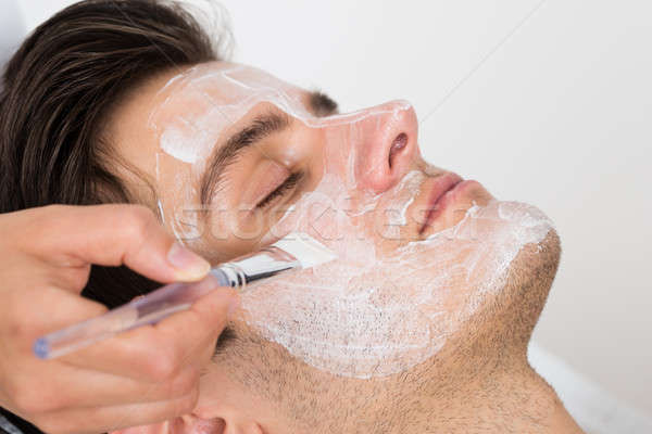 Therapist Applying Face Mask To Man Stock photo © AndreyPopov