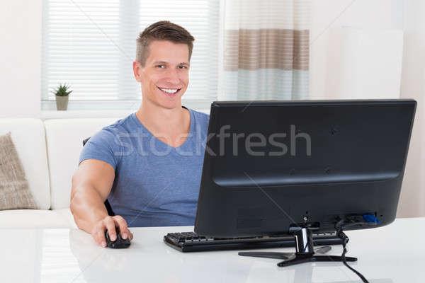 Man Using Desktop Computer Stock photo © AndreyPopov