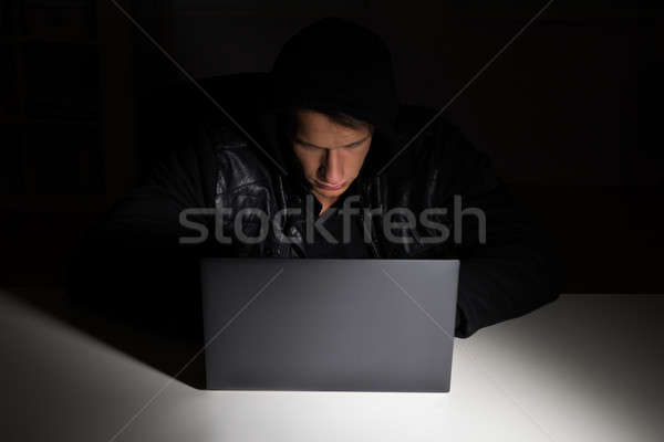Hacker Stealing Data From Laptop Stock photo © AndreyPopov