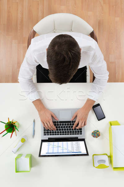 Businessman Working On Laptop Showing Gantt Chart Stock photo © AndreyPopov