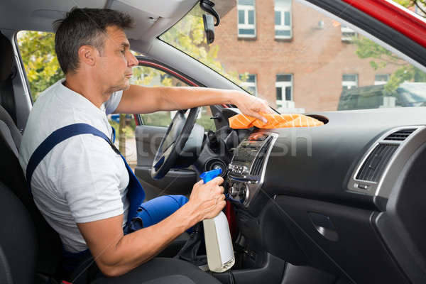 Male Worker Cleaning Car Interior Stock photo © AndreyPopov