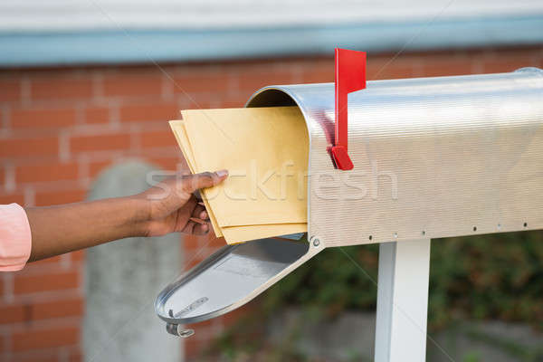 Person Putting Letters In Mailbox Stock photo © AndreyPopov
