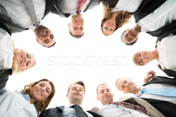Portrait Of Confident Business Team Standing In Huddle Stock photo © AndreyPopov