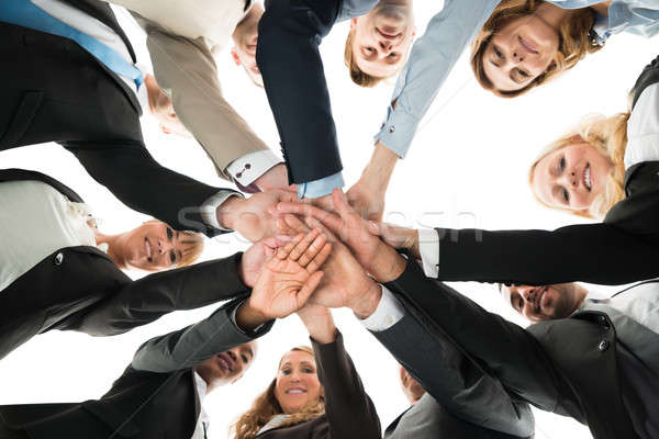 Confident Business Team Stacking Hands While Standing In Huddle Stock photo © AndreyPopov