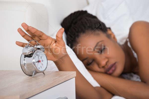 Kadın Alarm uyku yatak genç Stok fotoğraf © AndreyPopov