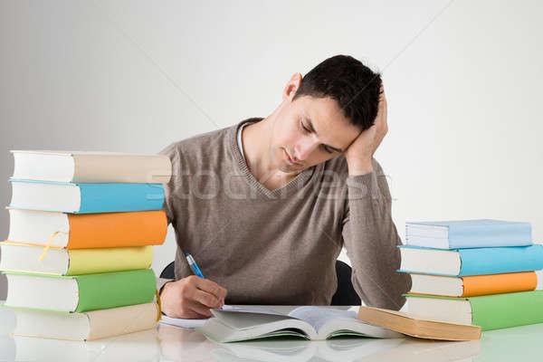 Kimerült férfi tanul asztal fehér diák Stock fotó © AndreyPopov