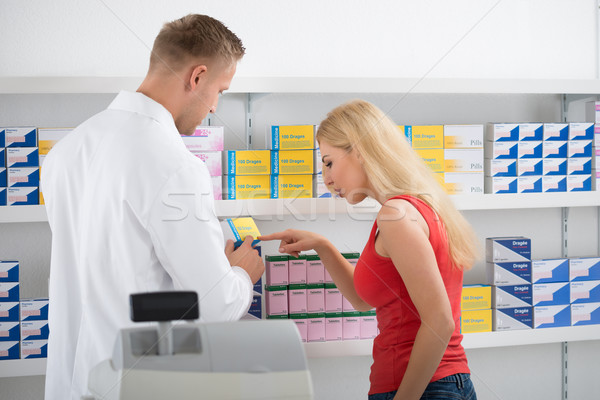 Woman Discussing Over Medicines With Pharmacist Stock photo © AndreyPopov