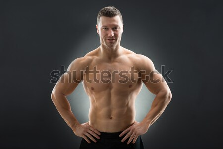 e515d6436 #6689886 Confident Muscular Man Standing With Hands On Hip by ...