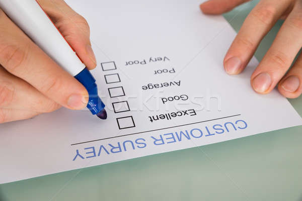 Person Hand Marking On Customer Survey Form Stock photo © AndreyPopov